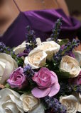Pretty Bouquet. A pretty bouquet of paper flowers and a bridesmaid in the background in a hot purple dress Royalty Free Stock Images