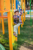 Pretty boy in cap on the playground Royalty Free Stock Image