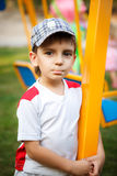 Pretty boy in cap on the playground Royalty Free Stock Images