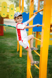 Pretty boy in cap on the playground Royalty Free Stock Photo
