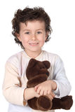 Pretty boy in pajamas with teddy bear Royalty Free Stock Image
