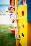 Pretty boy on the playground Royalty Free Stock Image