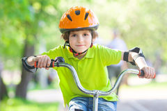 Pretty boy rides cycle Stock Photo