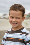 Pretty boy smiling on beach Royalty Free Stock Photography