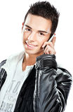 Pretty boy talking over mobile phone Royalty Free Stock Image