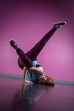 Pretty break dancer busting a move Royalty Free Stock Images