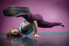 Pretty break dancer busting a move Royalty Free Stock Photos