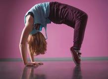 Pretty break dancer doing a back bend Stock Photo
