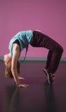 Pretty break dancer doing a back bend Royalty Free Stock Image
