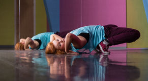 Pretty break dancer doing a back bend Stock Images