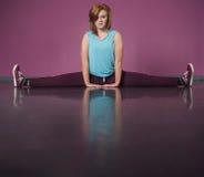 Pretty break dancer doing the splits. In the dance studio Stock Photos