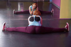 Pretty break dancer doing the splits looking in mirror Royalty Free Stock Photography