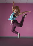 Pretty break dancer jumping up Royalty Free Stock Photography