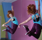 Pretty break dancer jumping up and looking in mirror Royalty Free Stock Photos