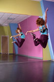 Pretty break dancer jumping up and looking in mirror Royalty Free Stock Images