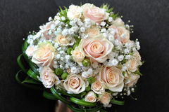 Pretty bridal bouquet with fresh roses Stock Images