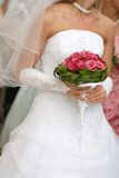 Pretty bride. A pretty bride with a bouquet red rose Royalty Free Stock Photography
