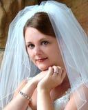 Pretty Bride. Closeup of bride standing near stone window stock photography