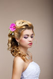 Dreams. Desire. Thoughtful Luxurious Bride Blonde - Gorgeous Hair Style. Purity Stock Photo