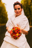 Pretty bride with bouquet in white stole Royalty Free Stock Photography
