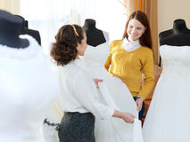 Pretty bride chooses bridal dress Royalty Free Stock Photo