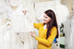 Pretty bride chooses outfit Royalty Free Stock Photos