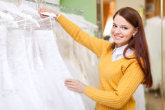 Pretty bride chooses  wedding dress Stock Photos