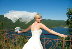 Pretty bride with a flying veil Royalty Free Stock Photography