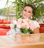 Pretty bride girl with flowers Stock Photography
