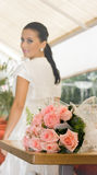 Pretty bride girl with flowers Stock Images