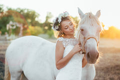 Pretty bride with horse Royalty Free Stock Images