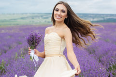 Pretty bride at purple lavender field Royalty Free Stock Photos