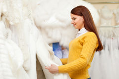 Pretty bride shopping for wedding outfit. In bridal boutique royalty free stock image