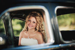 Pretty bride smiling Stock Images