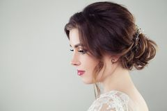 Pretty bride woman with bridal hair. Updo haircut with pearls hairdeco, face closeup.  royalty free stock images