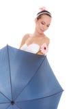 Pretty bride woman holding umbrella and flower. Stock Photos