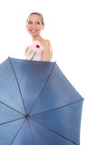 Pretty bride woman holding umbrella and flower. Stock Image