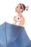 Pretty bride woman holding umbrella and flower. Royalty Free Stock Images