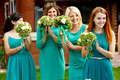 Pretty bridesmaids in mint dresses applaud during the ceremony.  Royalty Free Stock Photos
