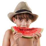 Pretty brown-eyed girl eating ripe watermelon Royalty Free Stock Photo