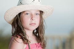 Pretty Brown Haired child with White Hat Royalty Free Stock Image