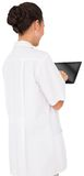 Pretty brown haired nurse using tablet pc Stock Photos