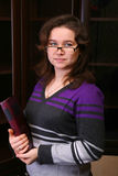 Pretty brunet girl with book. Royalty Free Stock Image