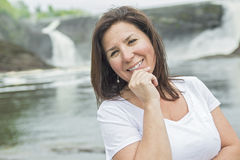 Pretty brunette adult woman portrait smiling outside Royalty Free Stock Images
