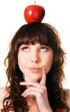 Pretty brunette with an apple on her head. Portrait of a cute brunette with an apple on her head, white background Stock Image