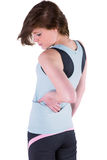 Pretty brunette with back injury Royalty Free Stock Photos