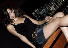 Pretty Brunette at the Bar Royalty Free Stock Photo