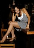 Pretty Brunette at the Bar Stock Photo