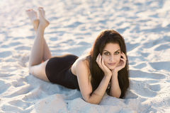 Pretty brunette on the beach background Stock Image