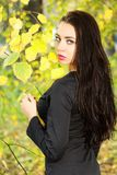 Pretty brunette in black Royalty Free Stock Photos